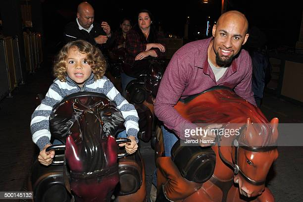 Hank Baskett and son Hank Baskett IV attend Knott's Merry Farm Countdown to Christmas Tree Lighting at Knott's Berry Farm on December 5 2015 in Buena...