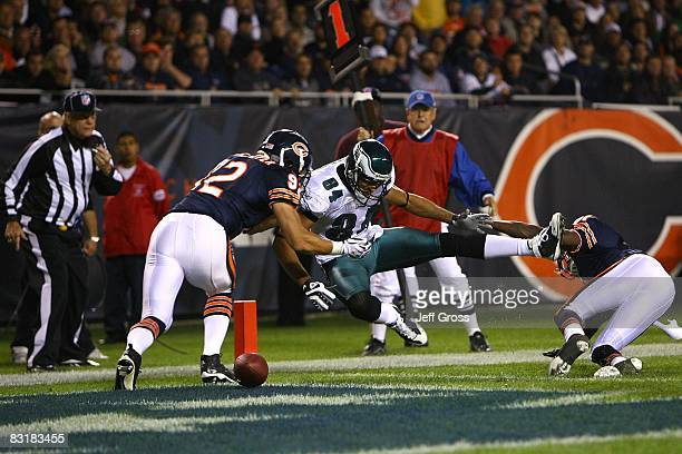 Hank Baskett of the Philadelphia Eagles can't make a catch in the endzone against Hunter Hillenmeyer and Nathan Vasher of the Chicago Bears at...