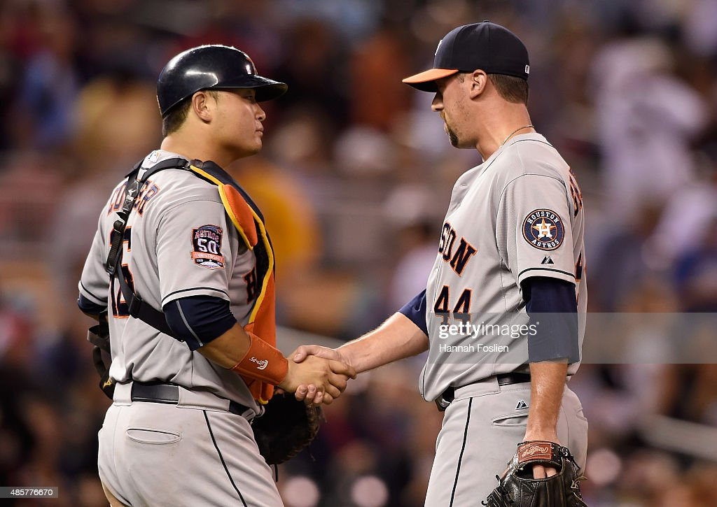 Hank Conger #16 and Luke Gregerson #44 of the Houston Astros celebrate a win of the game against the Minnesota Twins on August 29, 2015 at Target Field in Minneapolis, Minnesota. The Astros defeated the Twins 4-1.