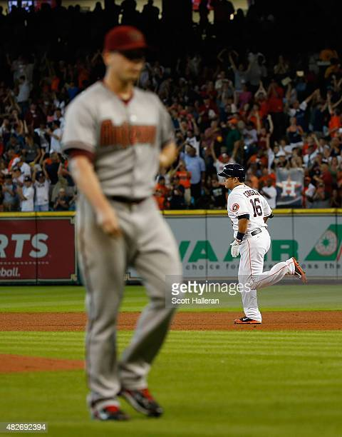 Hank Conger of the Houston Astros rounds the bases after hitting a grand slam in the fourth inning off Jeremy Hellickson of the Arizona Diamondbacks...