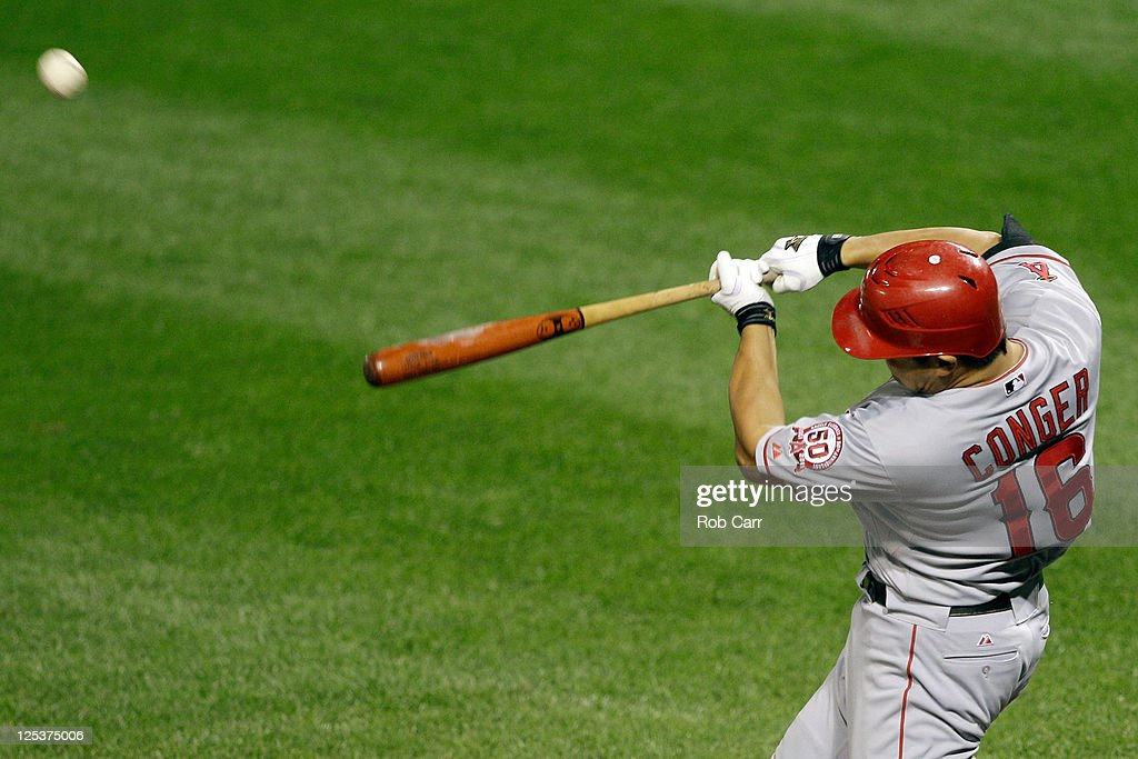 Hank Conger #16 of the Los Angeles Angels of Anaheim connects for a two RBI home run against the Baltimore Orioles during the ninth inning at Oriole Park at Camden Yards on September 16, 2011 in Baltimore, Maryland. The Orioles won 8-3.