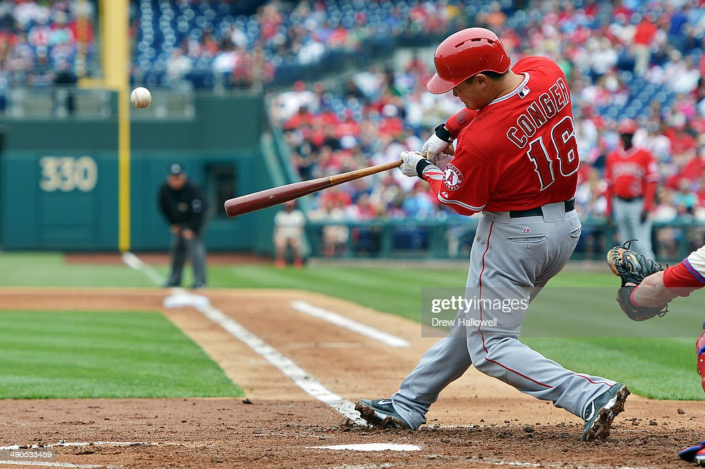 Hank Conger #16 of the Los Angeles Angels of Anaheim hits a single in the second inning against the Philadelphia Phillies at Citizens Bank Park on May 14, 2014 in Philadelphia, Pennsylvania.