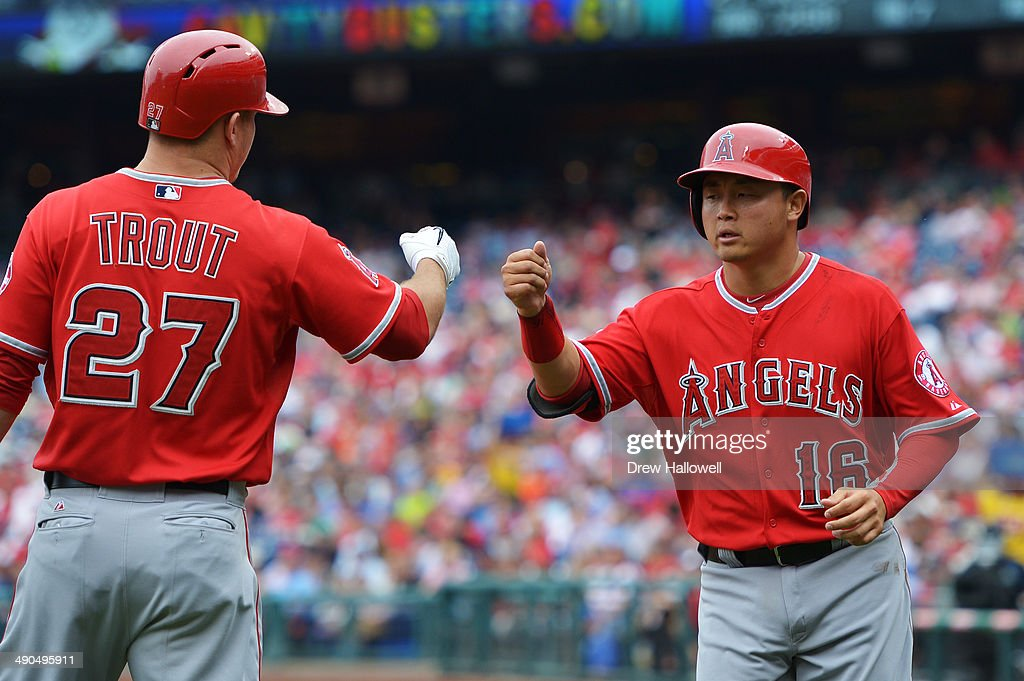 Hank Conger #16 of the Los Angeles Angels of Anaheim is congratulated by Mike Trout #27 for a run scored in the second inning at Citizens Bank Park on May 14, 2014 in Philadelphia, Pennsylvania.