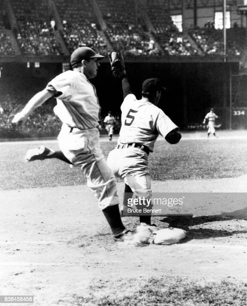 Hank Greenberg of the Detroit Tigers catches the ball as Warren Rosar of the Philadelphia Athletics is out as he crosses first base during an MLB...