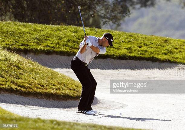 Hank Kuehne blasts from the sand on the fifth hole at Torrey Pines Golf Course, site of the Buick Invitational, during final-round play February 15,...