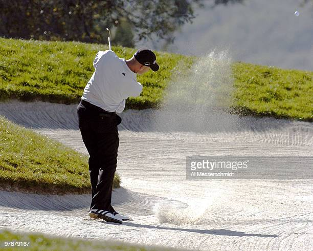 Hank Kuehne blastst from the sand on the fifth hole at Torrey Pines Golf Course, site of the Buick Invitational, during final-round play February 15,...
