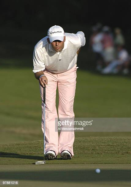Hank Kuehne lines up a putt on the 18th green during third-round competition at the Funai Classic, October 23, 2004.