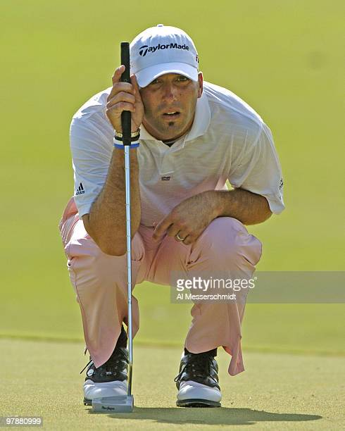 Hank Kuehne lines up a putt on the eighth green during third-round competition at the Funai Classic, October 23, 2004.