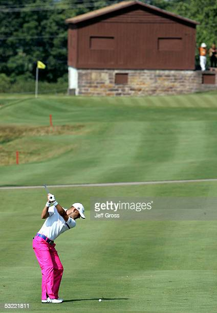 Hank Kuehne of the USA hits his second shot from the second fairway during the final round of the John Deere Classic on July 10, 2005 at TPC at Deere...