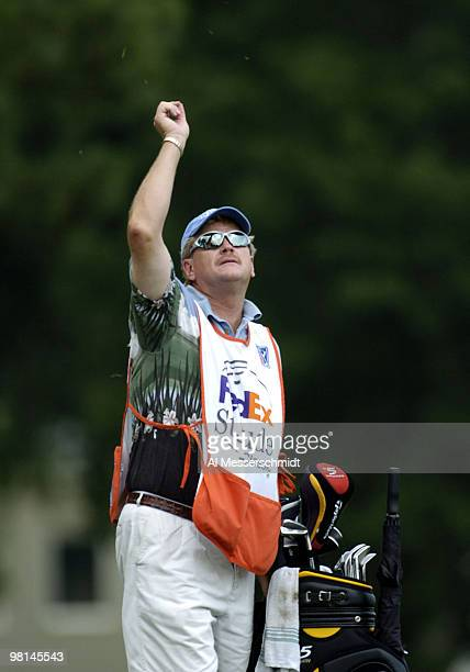Hank Kuehne's caddy checks the wind during third-round play at the FedEx St. Jude Classic May 29, 2004 at the Tournament Players Club Southwind,...