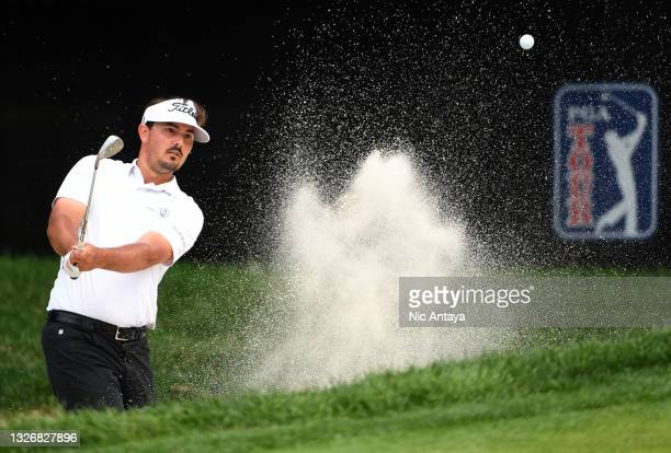 Hank Lebioda plays a shot from a bunker on the ninth hole during the third round of the Rocket Mortgage Classic on July 03, 2021 at the Detroit Golf...