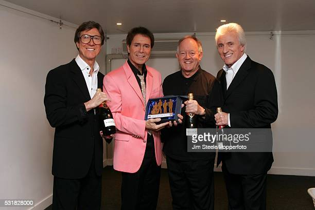 Hank Marvin Cliff Richard Brian Bennett and Bruce Welch of The Shadows posing for a photograph as the band receives a special award from Wembley...
