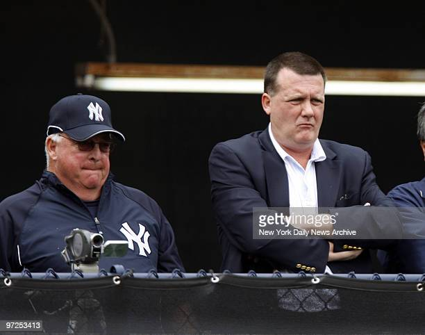 Hank Steinbrenner and guest instructor Stump Merrill watch as pitchers throw in the bullpen at Legends Field during team's first fullsquad workout at...