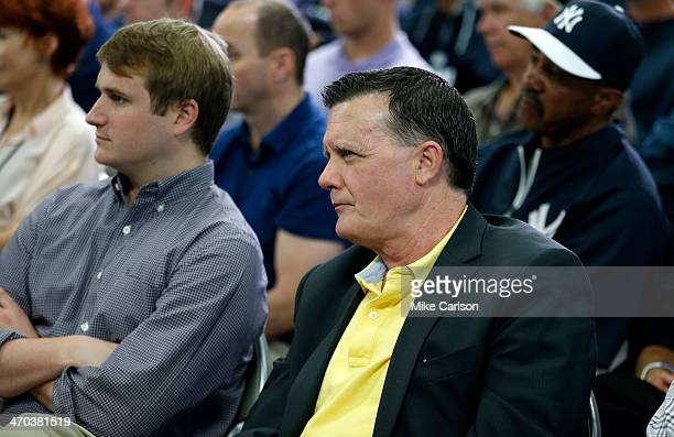 Hank Steinbrenner General Partner and CoChairperson of the New York Yankees watches as Derek Jeter speaks at a media availability after announcing...