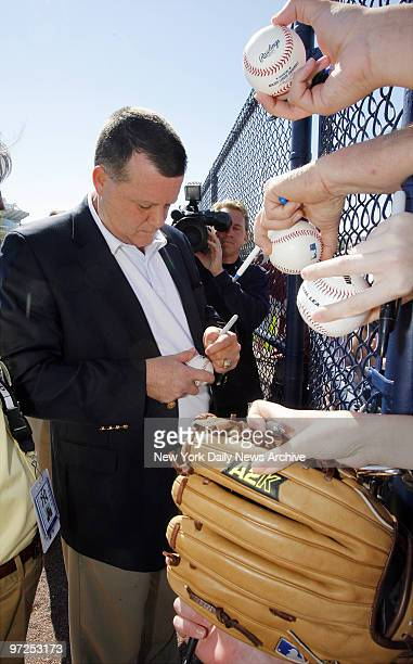 Hank Steinbrenner senior vice president of the New York Yankees signs autographs for fans at Legends Field during spring training camp