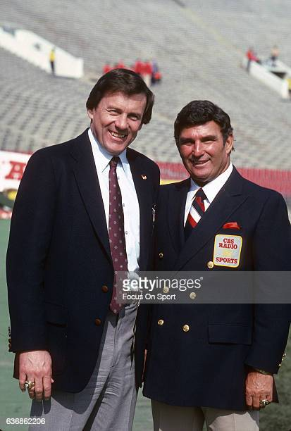 Hank Stram CBS Radio Sports commentator poses with Len Dawson NBC television football analyst prior to the start of an NFL football game circa 1983