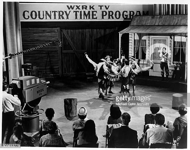 Hank Williams Jr competes with a rollicking group of square dancers on a television show in a scene from the movie A Time to Sing circa 1968