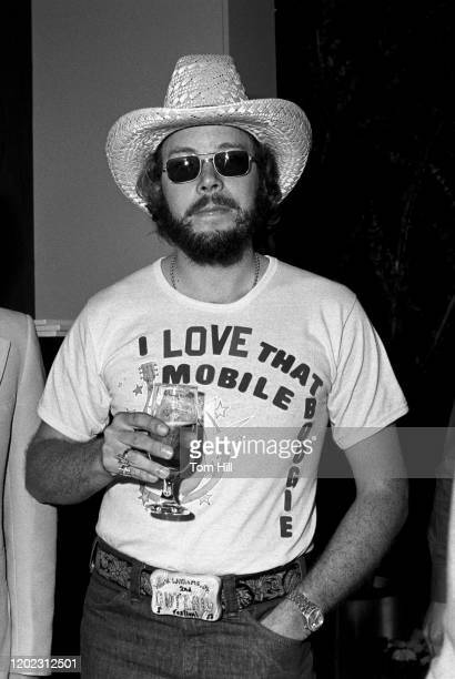Hank Williams Jr enjoys a drink before performing for a record industry audience at Stouffer's Hotel on May 26 1977 in Atlanta Georgia