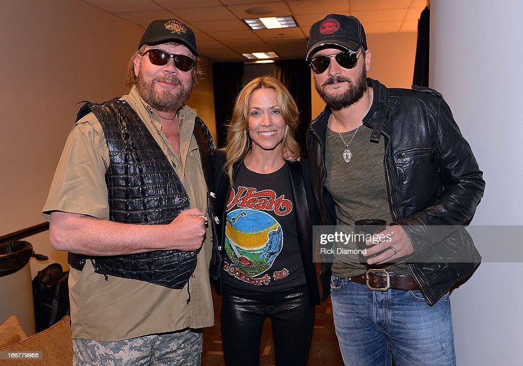 Hank Williams Jr, Sheryl Crow, and Eric Church backstage during Keith Urban's Fourth annual We're All For The Hall benefit concert at Bridgestone Arena on April 16, 2013 in Nashville, Tennessee.