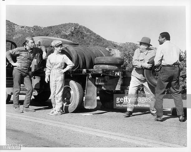 Hank Williams JrEd Begleyand D'Urville Martin borrow tire from mechanic Shelley Fabares in a scene from the film 'A Time to Sing' 1968