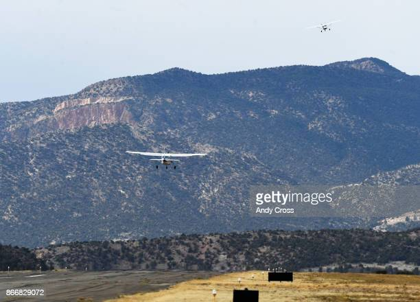 Hank Williams left and Ward Priestley top right take off from the Nucla Hopkins Airport October 19 2017 Williams owner of Williams construction and...