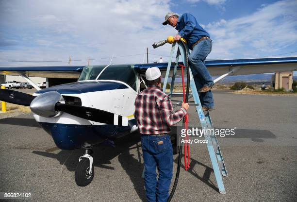 Hank Williams right and Ward Priestley fuel up Williams' Cessna at the Nucla Hopkins Airport October 19 2017 Williams owner of Williams construction...