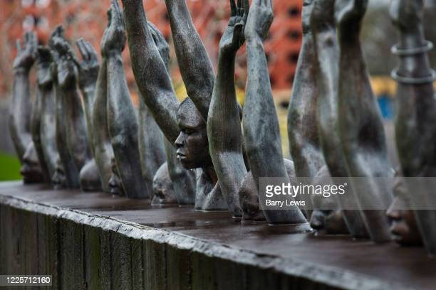 Hank Willis Thomas' 'Raise Up' statue which depicts contemporary issues of police violence and racially biased criminal justice in the National...