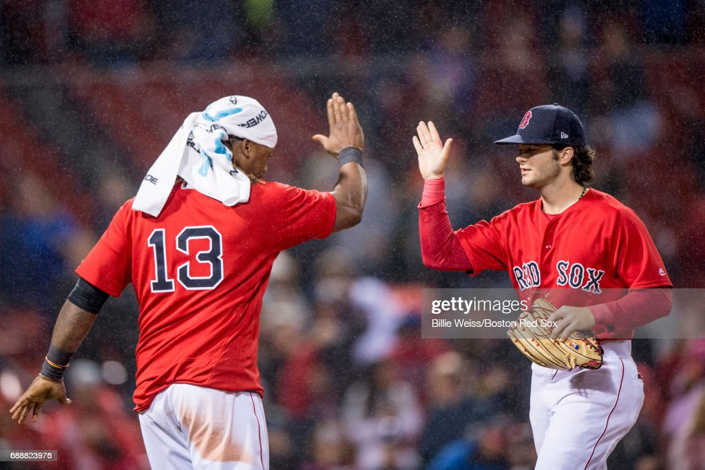 Hanley Ramirez #13 and Andrew Benintendi #16 of the Boston Red Sox celebrates a victory against the Seattle Mariners on May 26, 2017 at Fenway Park in Boston, Massachusetts.