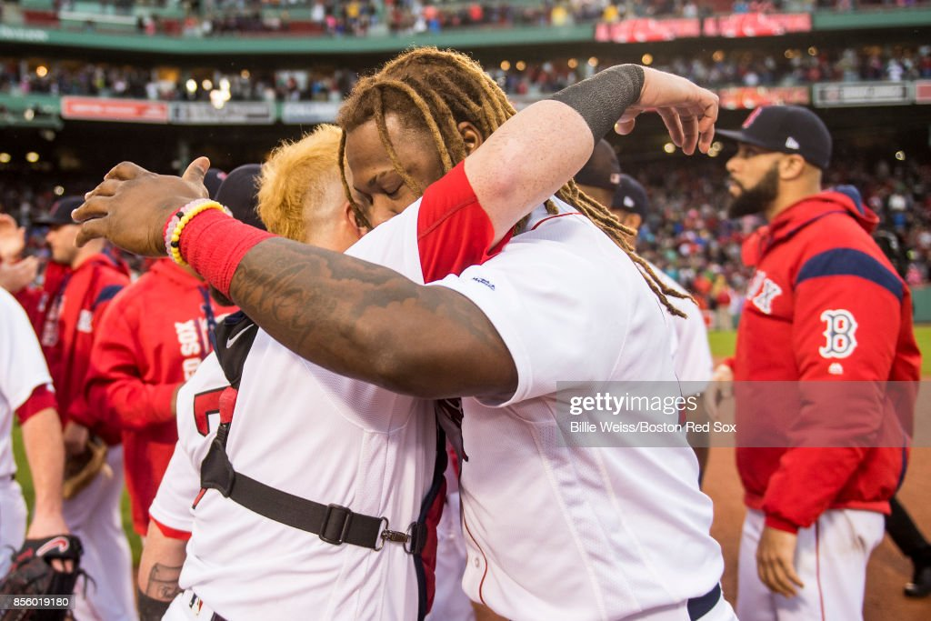 Hanley Ramirez #13 and Christian Vazquez #7 of the Boston Red Sox react after the final out was recorded to clinch the American League East Division against the Houston Astros on September 30, 2017 at Fenway Park in Boston, Massachusetts.