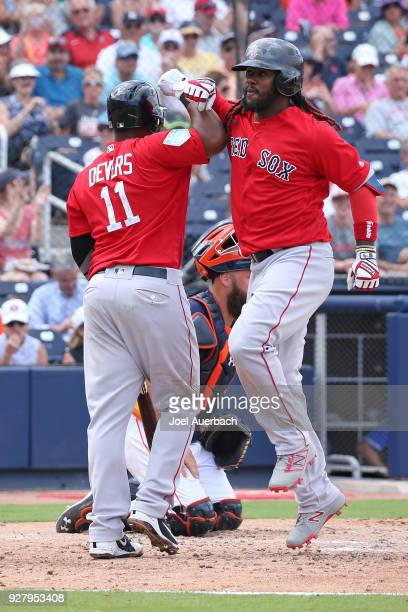 Hanley Ramirez celebrates his home run with Rafael Devers of the Boston Red Sox against the Houston Astros during a spring training game at The...