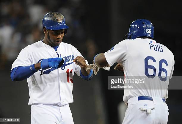 Hanley Ramirez celebrates with teammate Yasiel Puig of the Los Angeles Dodgers in the seventh inning against the Philadelphia Phillies at Dodger...