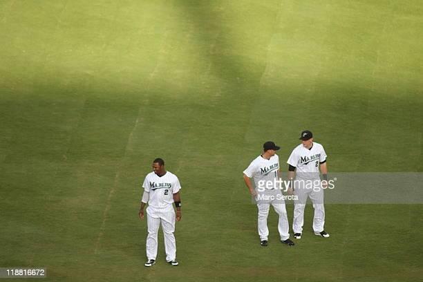 Hanley Ramirez Gaby Sanchez and Logan Morrison of the Florida Marlins prepare to play against the Houston Aatros at Sun Life Stadium on July 9 2011...