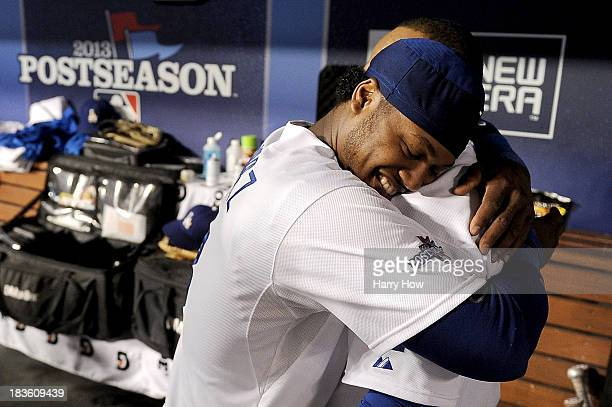 Hanley Ramirez hugs Juan Uribe of the Los Angeles Dodgers after Uribe hits a tworun home run in the eighth inning against the Atlanta Braves in Game...
