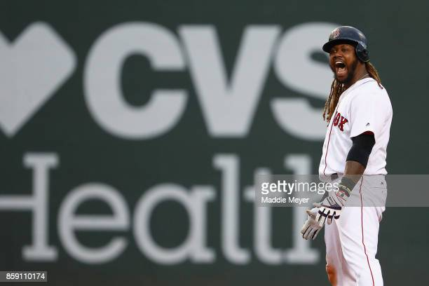 Hanley Ramirez of the Boston Red Sox celebrates after hitting a tworun RBI double in the seventh inning against the Houston Astros during game three...