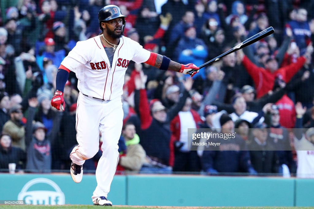 Hanley Ramirez #13 of the Boston Red Sox celebrates after hitting a walk off single, driving in Jackie Bradley Jr. #19, during the twelfth inning of the Red Sox home opening game against the Tampa Bay Rays at Fenway Park on April 5, 2018 in Boston, Massachusetts.
