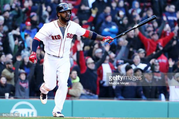Hanley Ramirez of the Boston Red Sox celebrates after hitting a walk off single driving in Jackie Bradley Jr #19 during the twelfth inning of the Red...