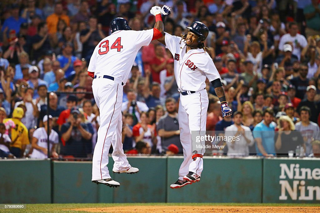 Hanley Ramirez #13 of the Boston Red Sox celebrates with David Ortiz #34 after hitting a three-run home run during the second inning against the Minnesota Twins at Fenway Park on July 23, 2016 in Boston, Massachusetts.