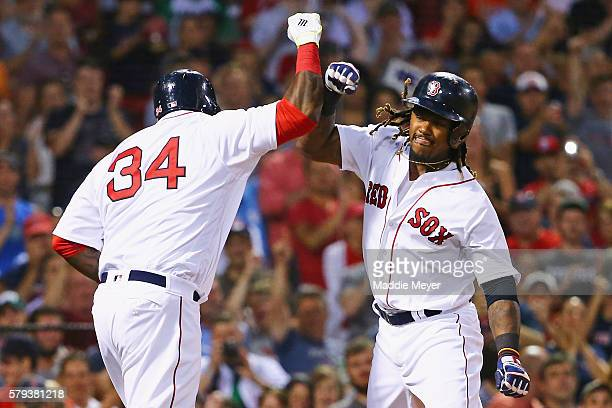 Hanley Ramirez of the Boston Red Sox celebrates with David Ortiz after hitting a three run homer during the second inning against the Minnesota Twins...