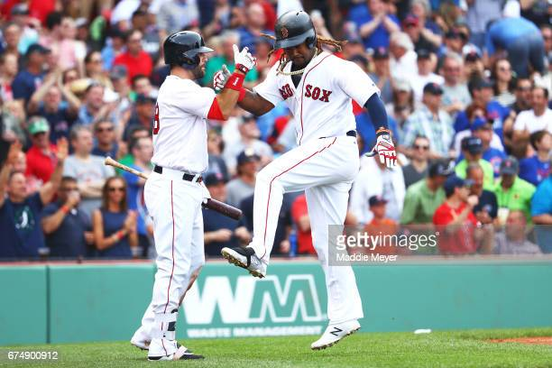Hanley Ramirez of the Boston Red Sox celebrates with Mitch Moreland after hitting a home run against the Chicago Cubs during the third inning at...