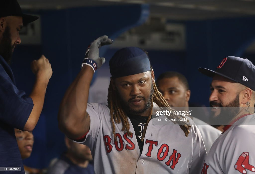 Hanley Ramirez #13 of the Boston Red Sox celebrates with teammates in the dugout after hitting a solo home run in the fifth inning during MLB game action against the Toronto Blue Jays at Rogers Centre on August 30, 2017 in Toronto, Canada.