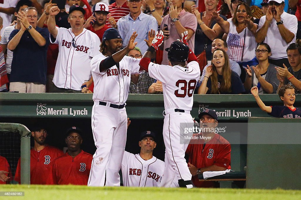 Hanley Ramirez #13 of the Boston Red Sox congratulates Rusney Castillo #38 after he hit a home run against the Chicago White Sox during the seventh inning at Fenway Park on July 30, 2015 in Boston, Massachusetts.