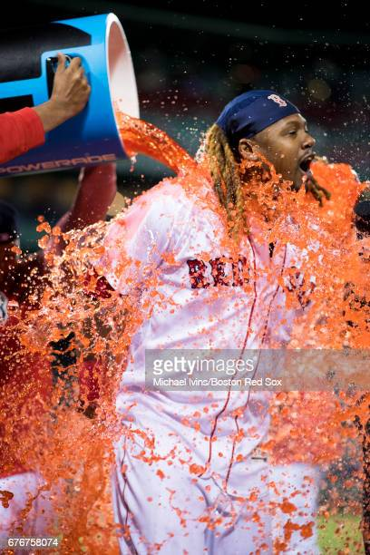 Hanley Ramirez of the Boston Red Sox gets doused by teammates after his two home run game led the team to a 52 win over the Baltimore Orioles at...