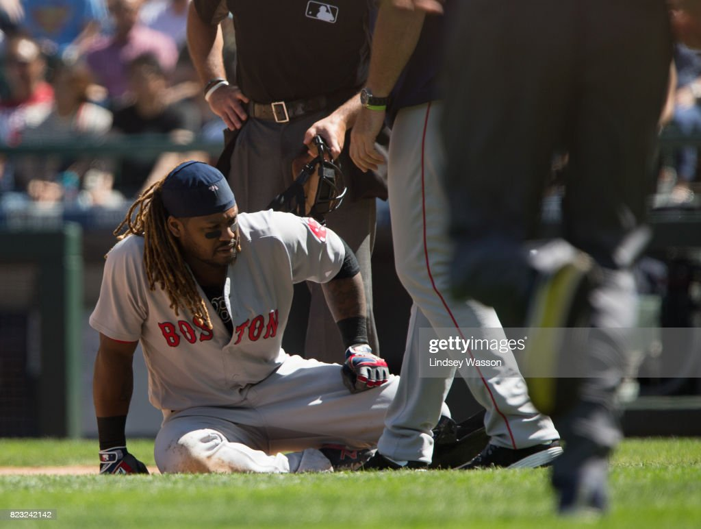 Hanley Ramirez #13 of the Boston Red Sox gets up off the ground as trainers come to look at him after being hit by a pitch in the eighth inning against the Seattle Mariners at Safeco Field on July 26, 2017 in Seattle, Washington.