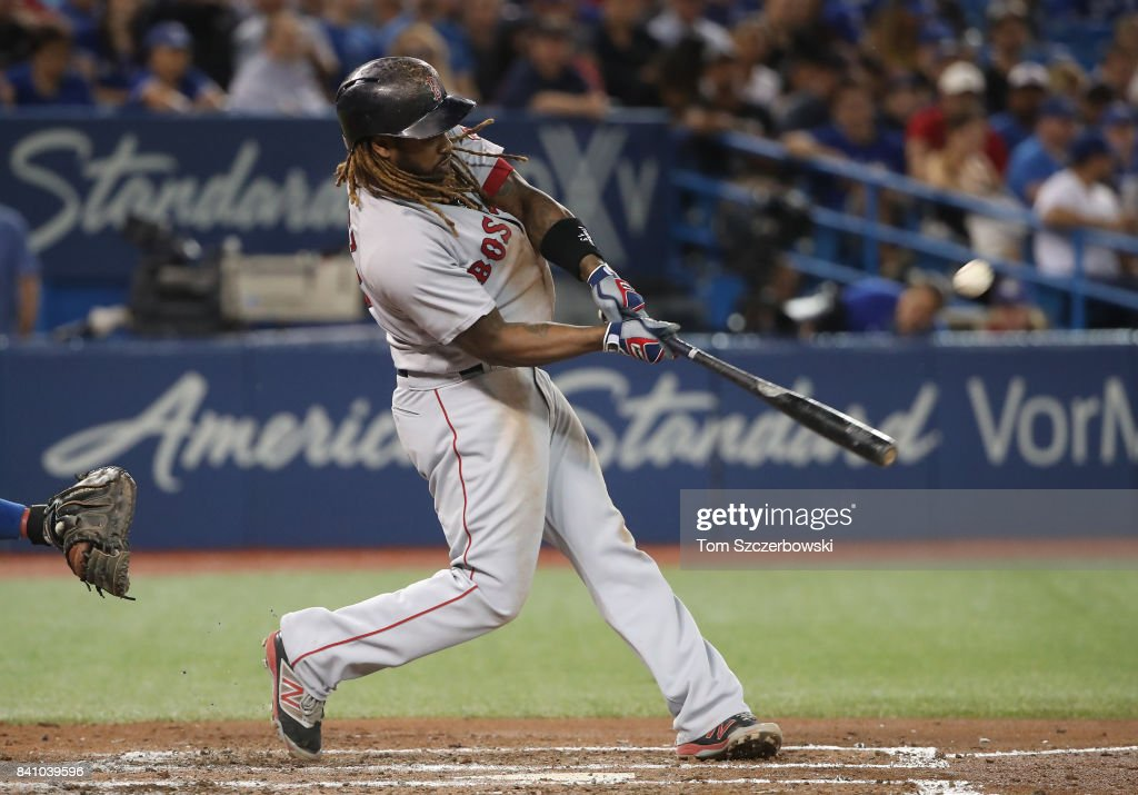 Hanley Ramirez #13 of the Boston Red Sox hits a solo home run in the fifth inning during MLB game action against the Toronto Blue Jays at Rogers Centre on August 30, 2017 in Toronto, Canada.
