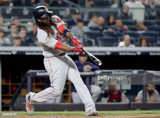 Hanley Ramirez of the Boston Red Sox hits a two run home run in the seventh inning against the New York Yankees at Yankee Stadium on May 9 2018 in...