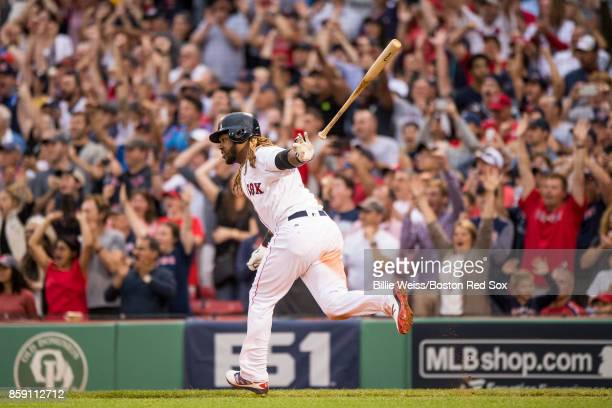 Hanley Ramirez of the Boston Red Sox hits an RBI double during the seventh inning of game three of the American League Division Series against the...