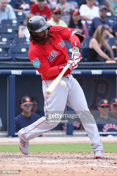 Hanley Ramirez of the Boston Red Sox hits the ball against the Houston Astros during a spring training game at The Ballpark of the Palm Beaches on...