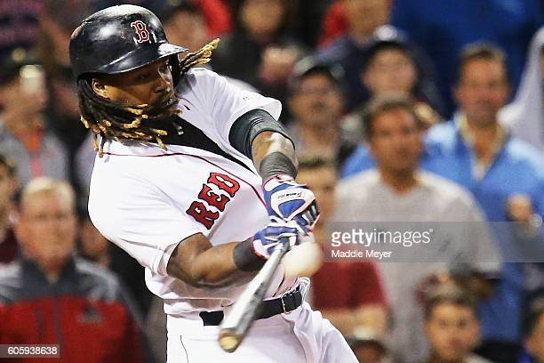 Hanley Ramirez of the Boston Red Sox hits the game winning three run homer against the New York Yankees during the ninth inning at Fenway Park on...