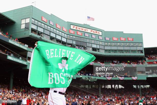 Hanley Ramirez of the Boston Red Sox holds a flag as he takes the field before game three of the American League Division Series between the Houston...