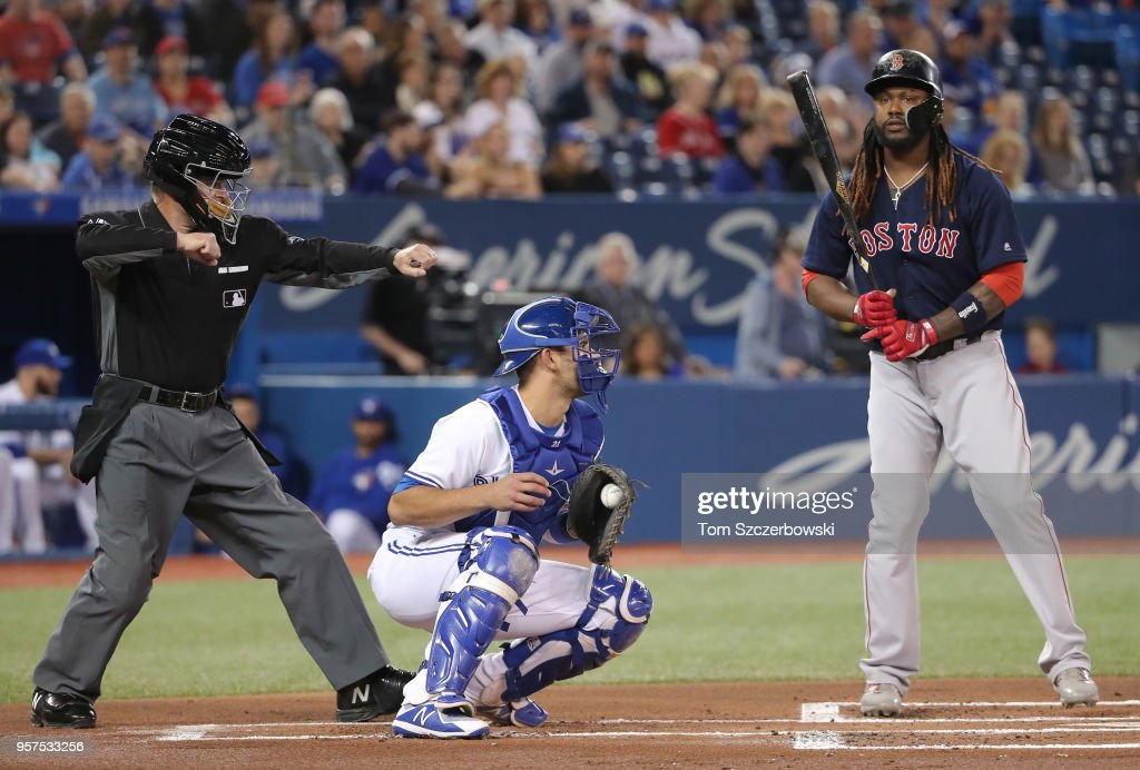 Hanley Ramirez #13 of the Boston Red Sox is called out on strikes by home plate umpire Ed Hickox #13 in the first inning during MLB game action against the Toronto Blue Jays at Rogers Centre on May 11, 2018 in Toronto, Canada.